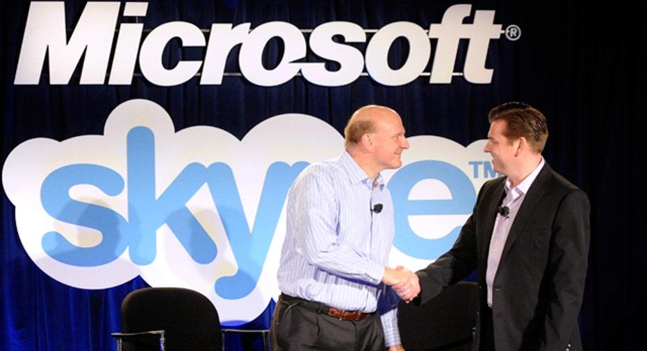 Microsoft CEO Steve Ballmer and Skype CEO Tony Bates Reuters