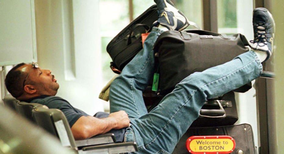 Passenger Sleeps at Airport, Reuters