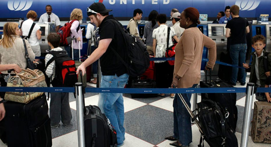people waiting in line to check in at airport