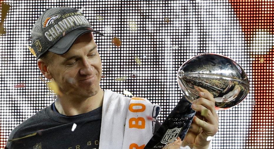 Peyton Manning holding Super Bowl trophy FBN