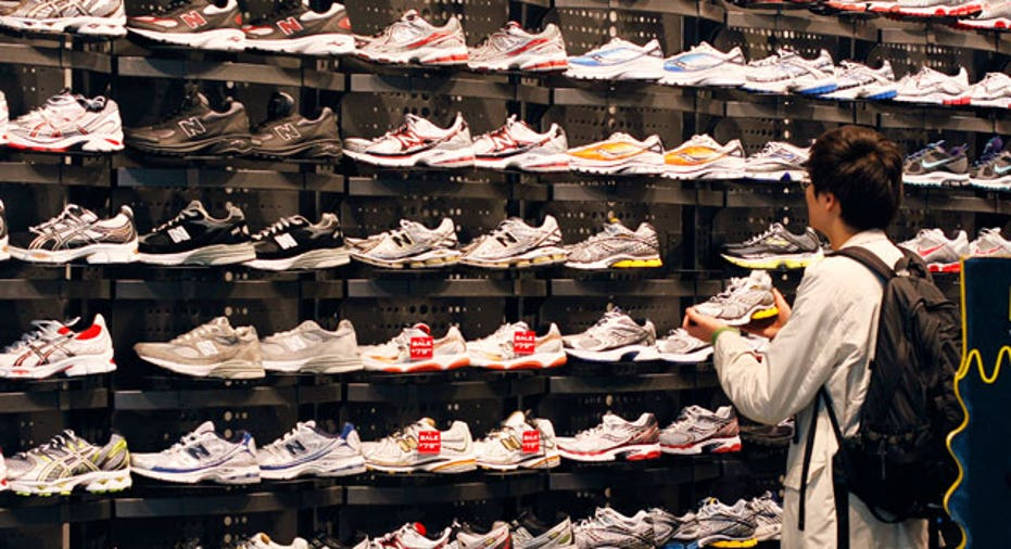 Shopper in Foot Locker, Reuters