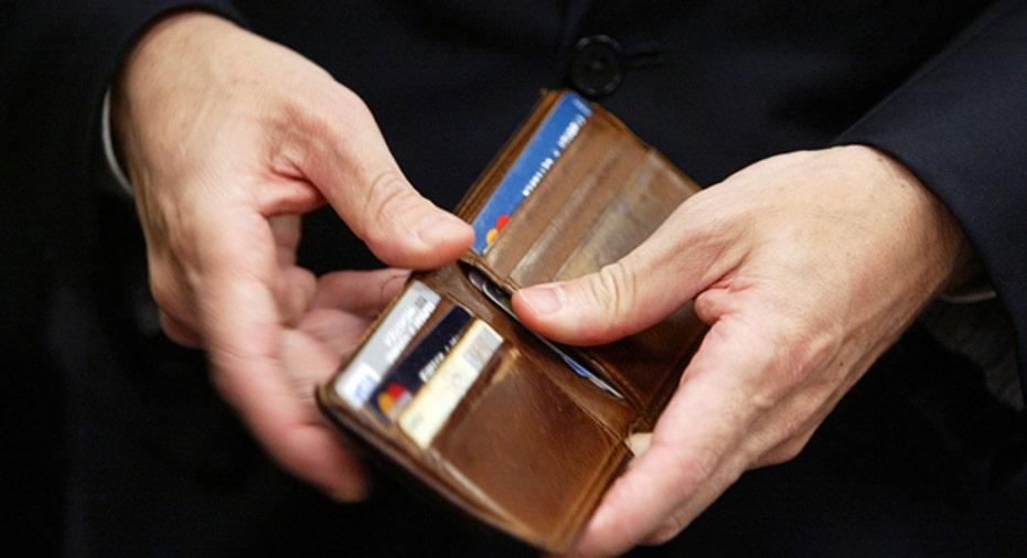 Man Opens Wallet, Reuters