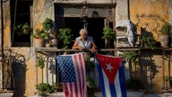 US slashes Cuba embassy staff, warns Americans not to visit