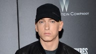 Eminem surprise album targets gun laws
