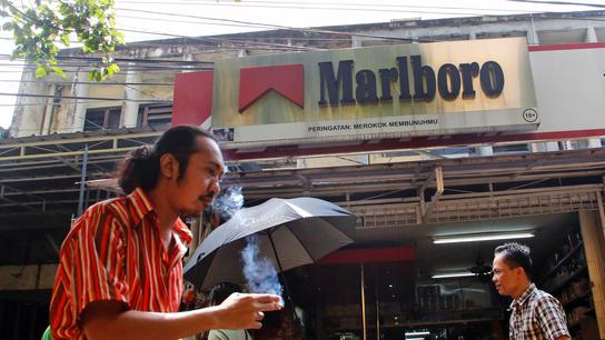 Philip Morris misses profit forecasts, shares fall
