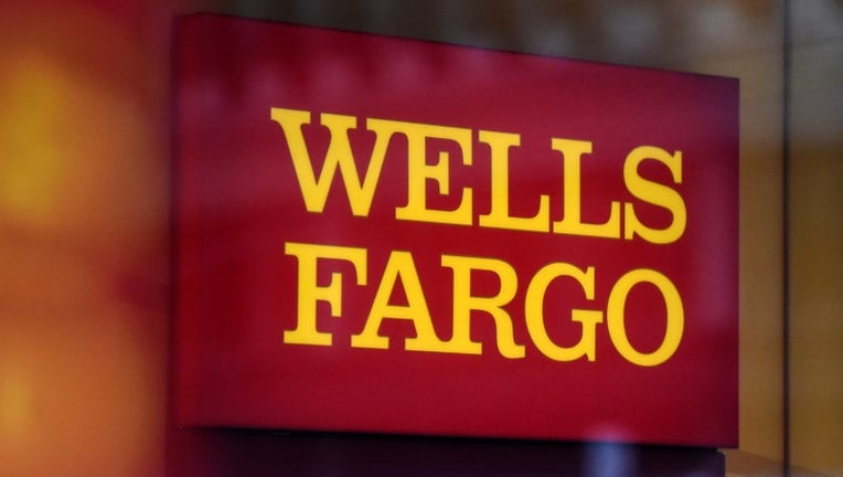 Wells Fargo to merge international business with wholesale