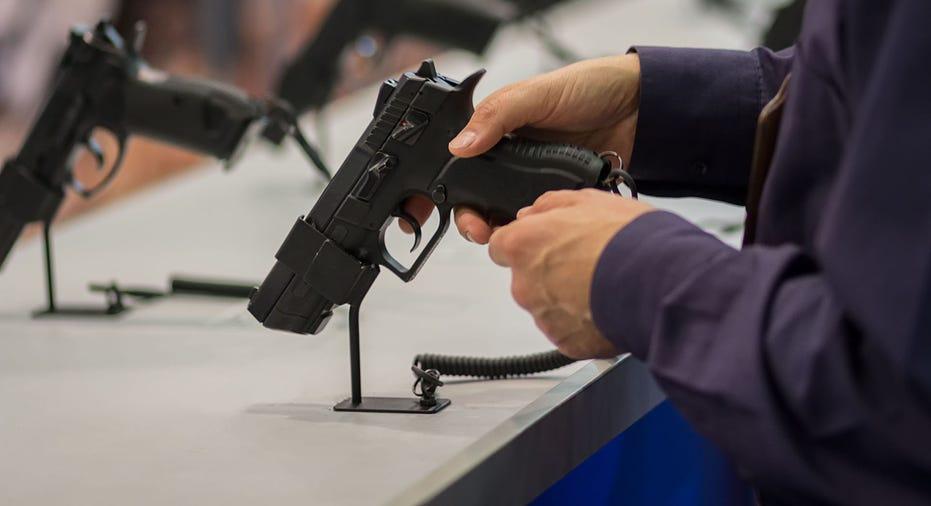 Gun in Hand iStock FBN