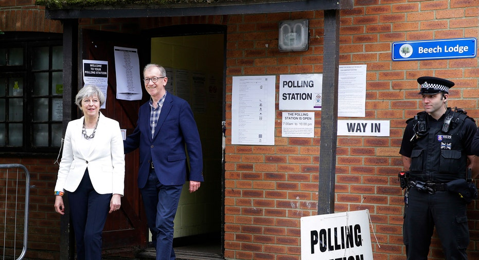 Theresa May and Husband Leave Polling Station AP FBN