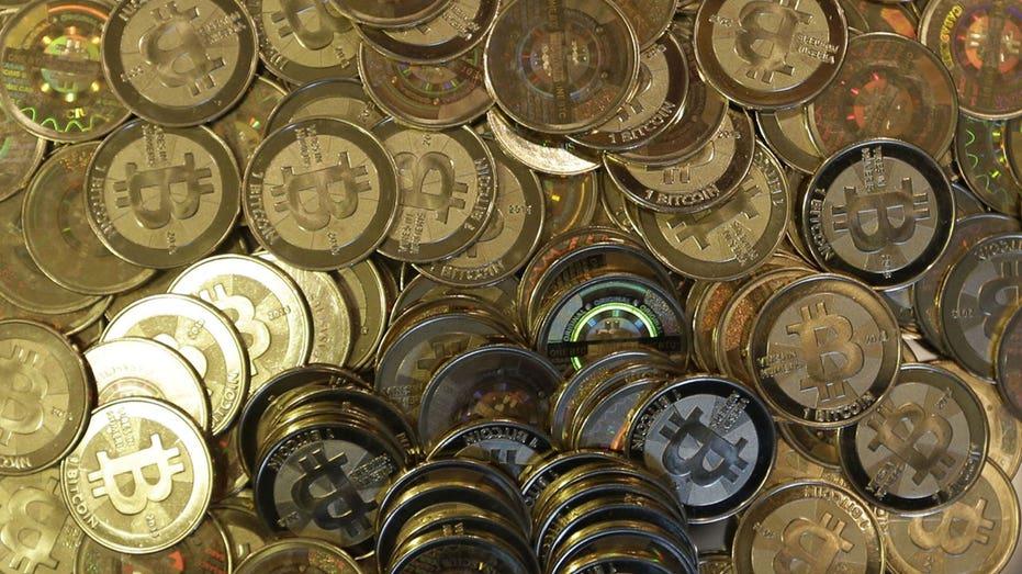 Bitcoins in a pile AP FBN