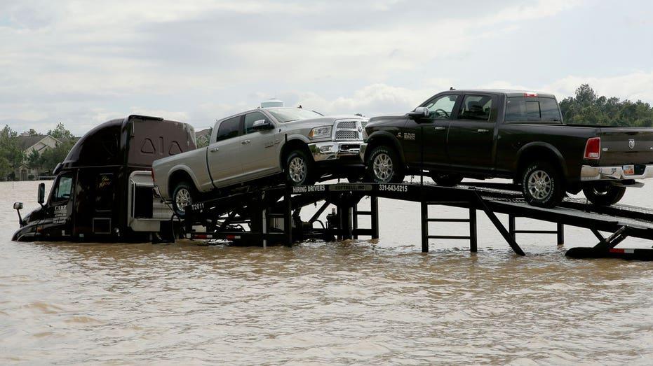 Hurricane Harvey stranded car transport truck AP FBN