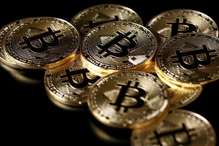2018 02 22t122520z 1 lynxnpee1l14d rtroptp 3 currency bitcoin