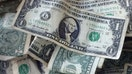 Dollar near one-month low on bets for later Fed taper