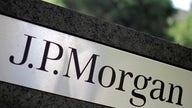 JPMorgan profit more than doubles, but revenue falls