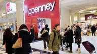JC Penney shrinks loss, shares spike