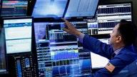 Dow hits record, Nasdaq falls for 4th session