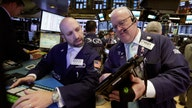 Dow, S&P hit records as jobs woes ease