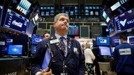 Stocks slide as oil hits 7-year high