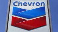Chevron takes $10B charge