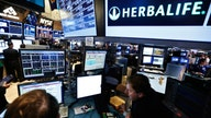 US charges two former Herbalife execs in bribery scheme