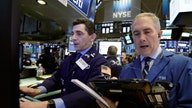Dow Jones hits record as Intel, Snap results weigh on tech