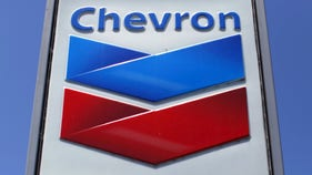 Chevron slashes value of holdings by $10 billion