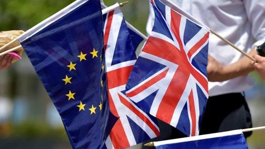 Brexit: UK's May, facing defeat, postpones vote