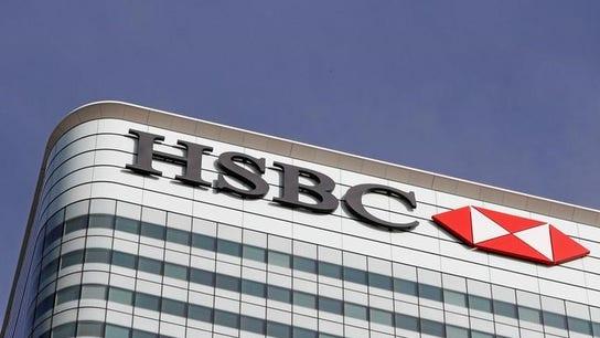 HSBC's 2017 profit jumps but below view