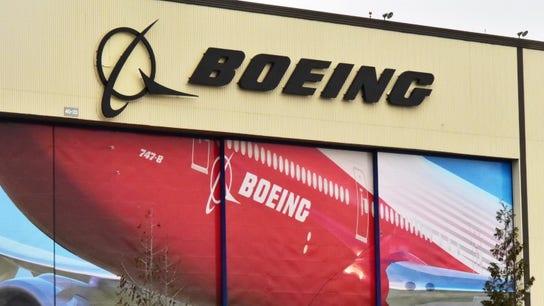 Boeing profit rises 57%