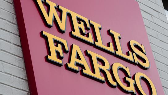 Wells Fargo shares sink after Federal Reserve crackdown