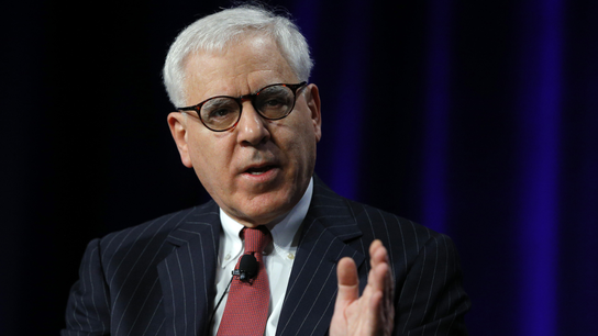 Carlyle's Rubenstein Sees a Rate Hike Later Rather Than Sooner