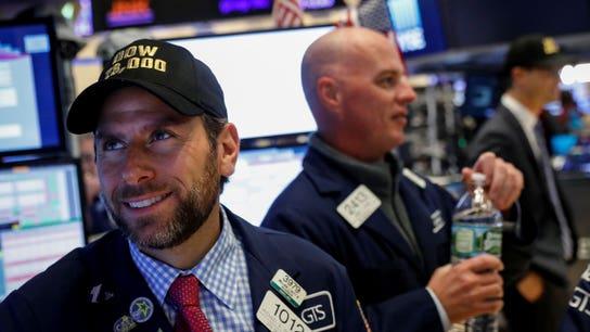 Dow sets record-high mark amid US-China trade tensions
