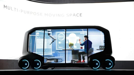Toyota unveils self-driving concept vehicle for rides, deliveries