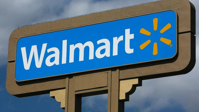 Wal-Mart's 2Q Earnings Beat, Outlook Raised, Shares Jump