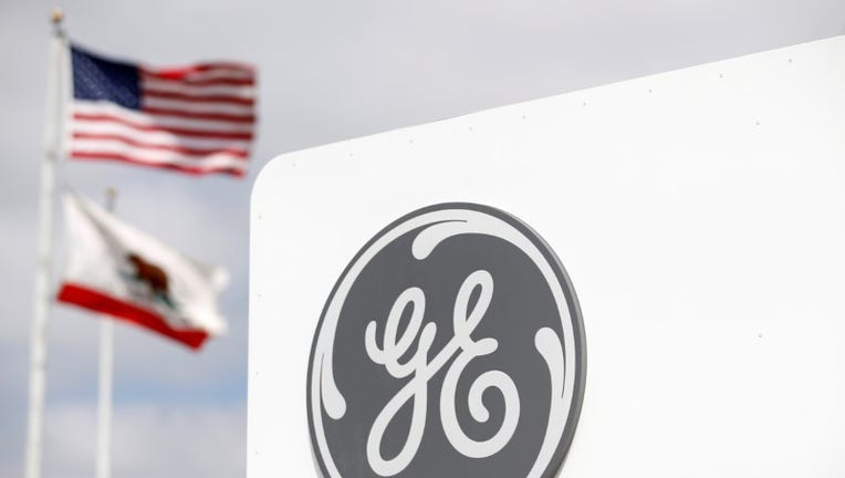 GE details compensation program, cuts bonuses