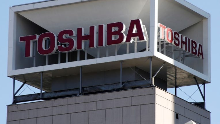 Toshiba signs deal to sell chip unit to Bain-Apple led group for $18 bln
