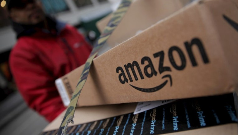 Amazon hits fresh record: Shares top $1K