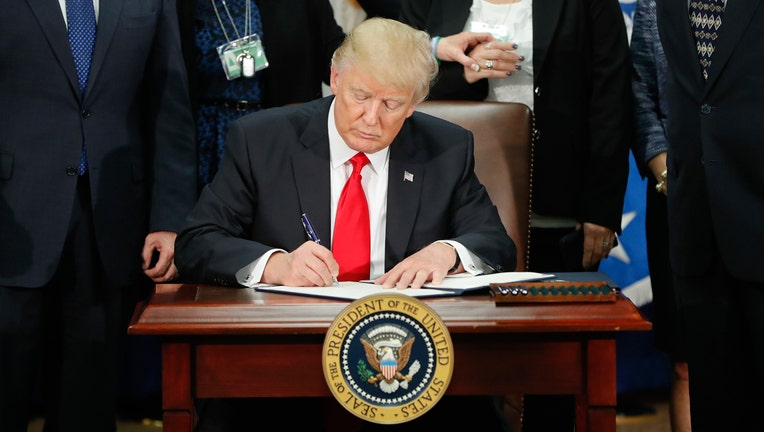 Trump Signs Executive Order to Slash Regulations 'Bigly'