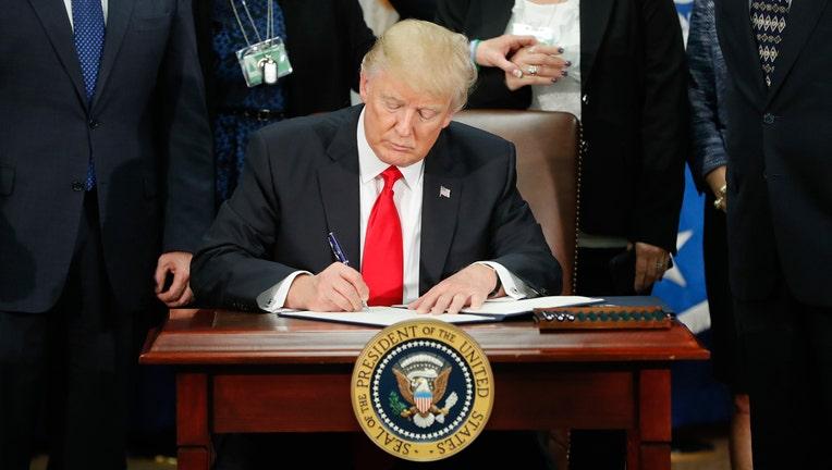 Trump Signs Executive Order to Slash Regulations 'Bigly'