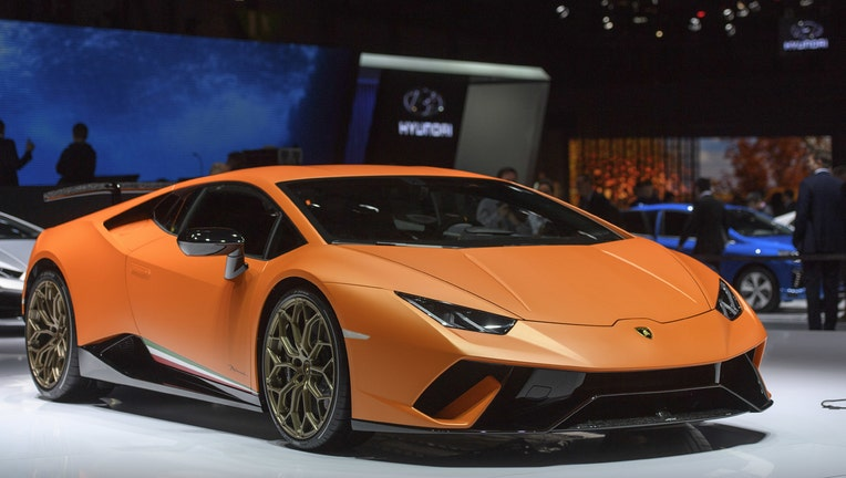 Suvs High End Sports Cars Provide The Roar At Geneva Show