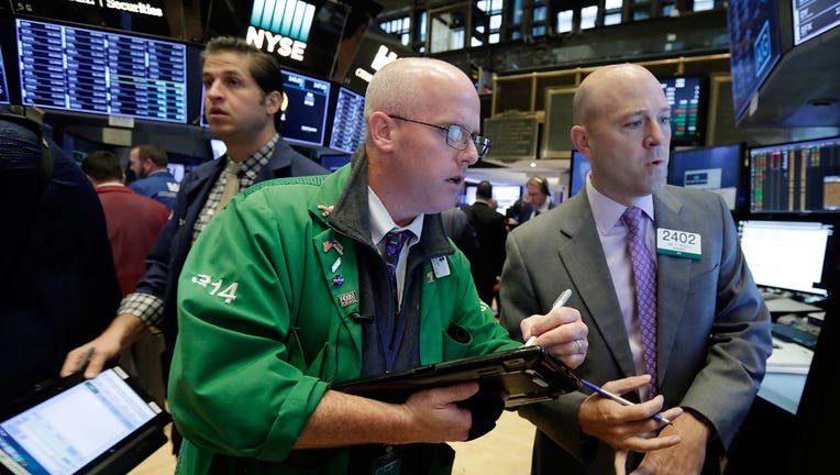 Wall Street opens flat, tech drags ahead of Fed