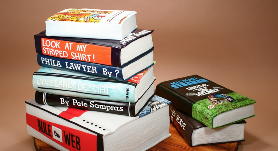 Stack of Sports Books Cake by Confetti Cakes