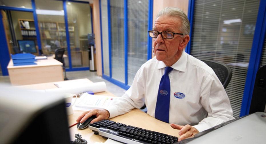 Elderly Man Working on Computer