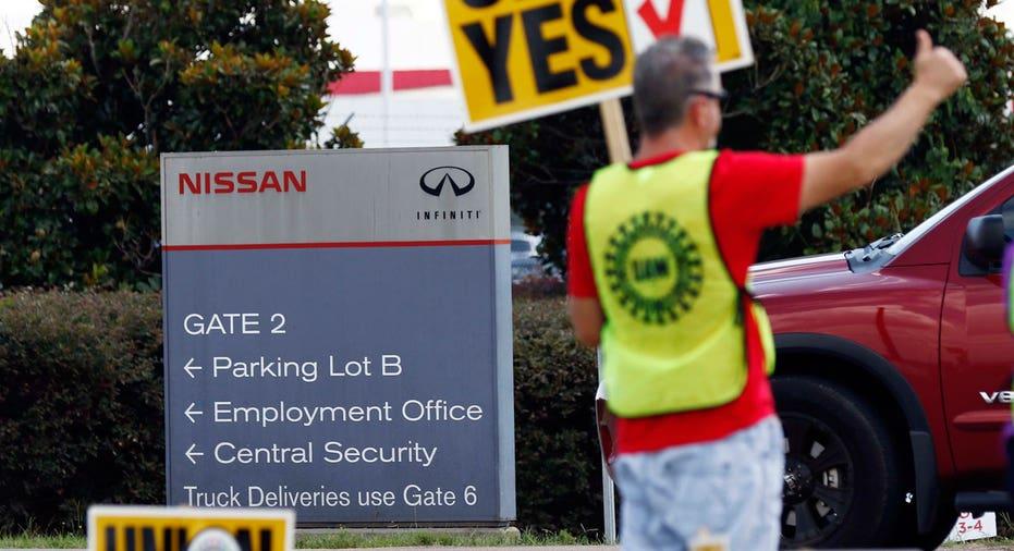 Nissan Mississippi UAW union vote sign FBN AP