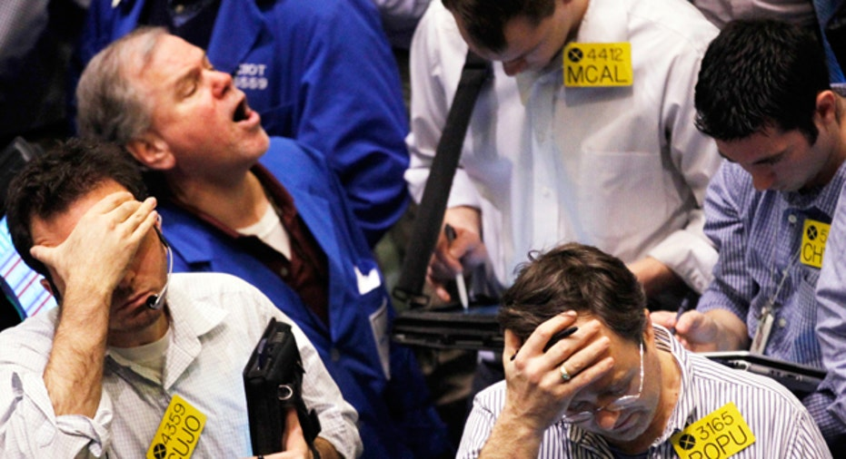 Traders at the New York Mercantile Exchange