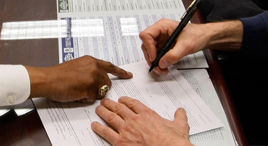 Signing Auto Loan at Dealership