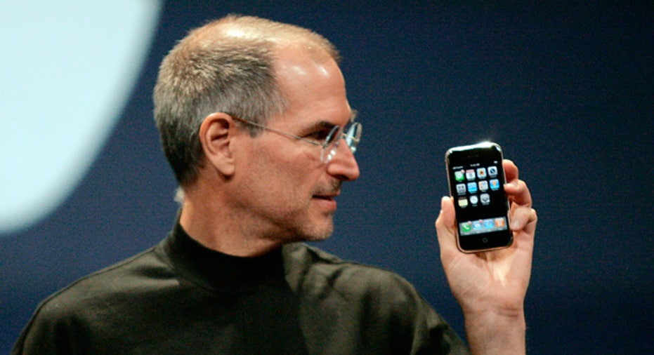 Apple CEO Steve Jobs Looks at iPhone