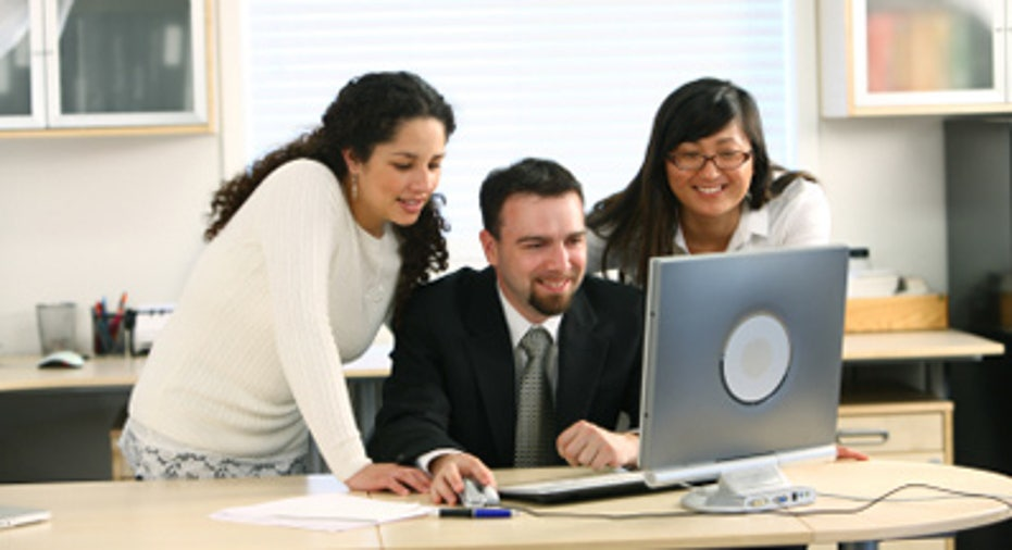 Small Business People Using Laptop
