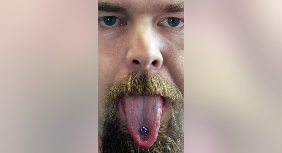man with tongue piercing