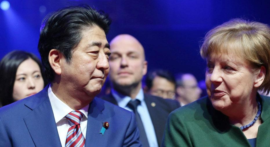 Abe and Merkel AP FBN
