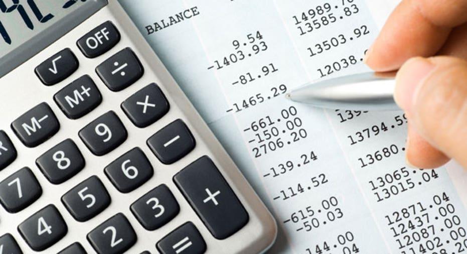 Calculator Lying on a Balance Sheet